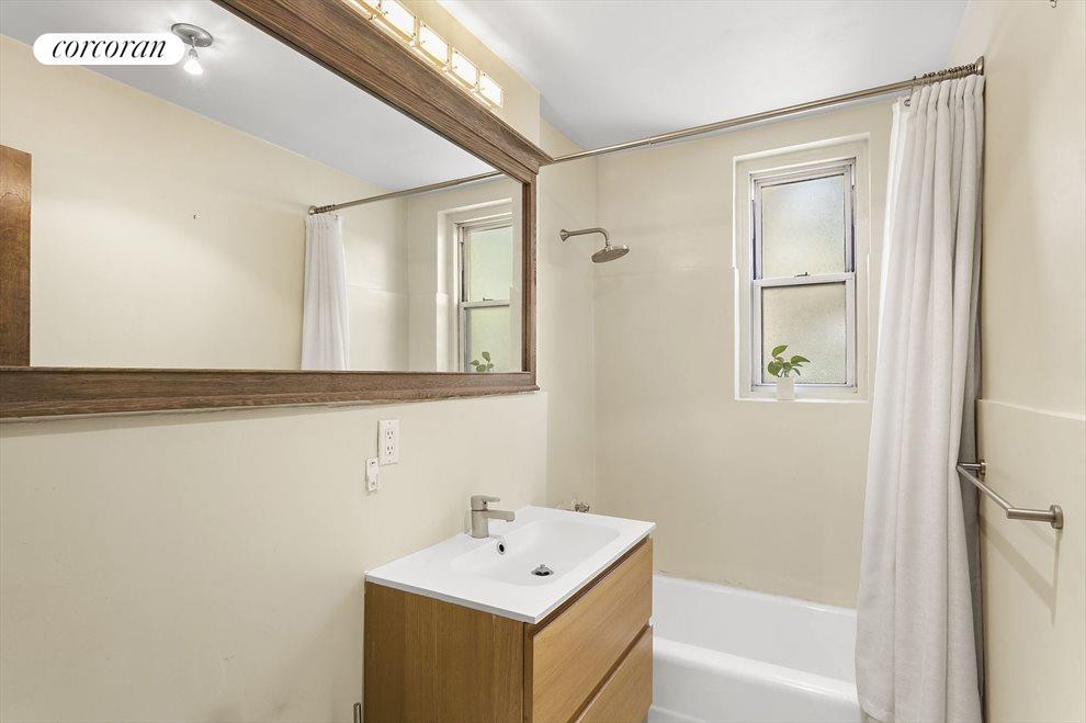 Windowed Bathroom With Custom Vanity & Lighting