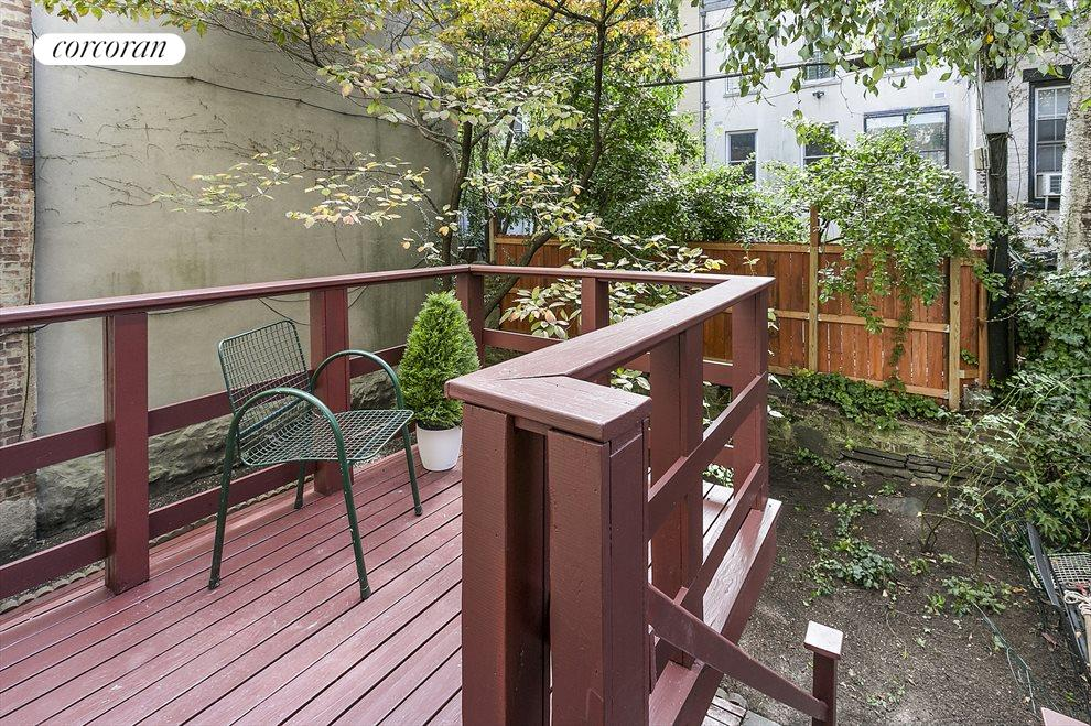 Deck Overlooks Tranquil Yard
