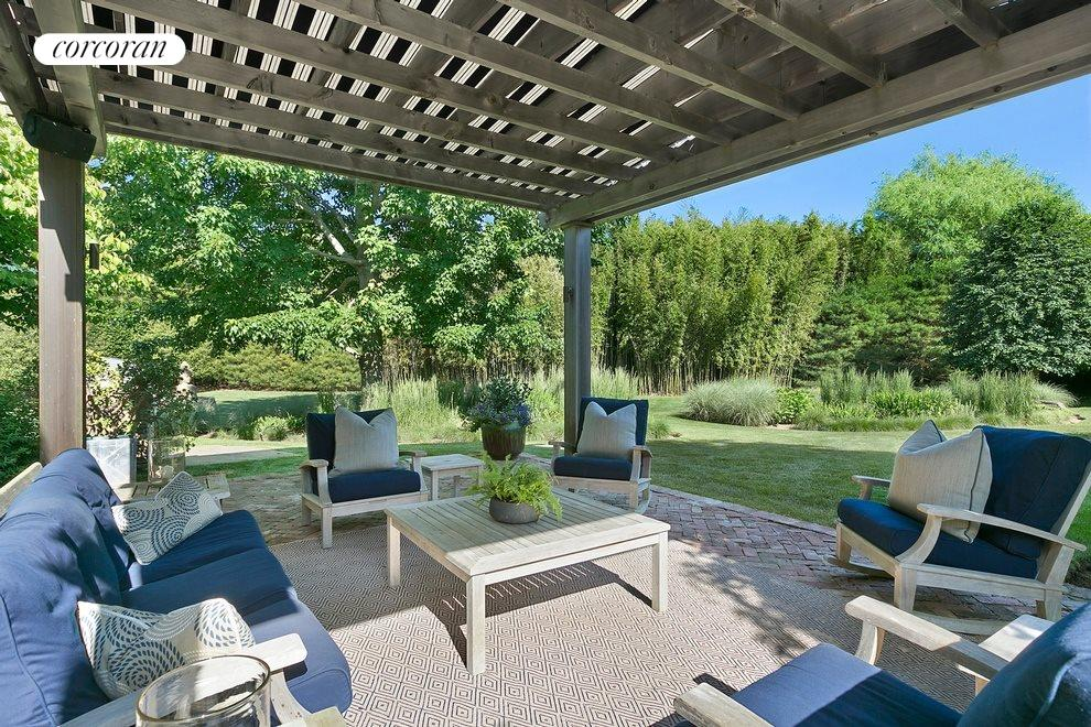 Relax and enjoy the gardens from this covered patio