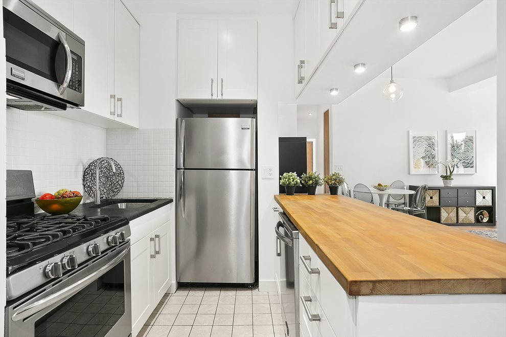 Double Height Cabinets and Stainless Appliances