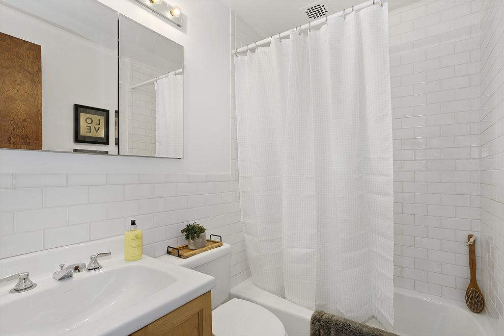Renovated Bath with Subway Tiles