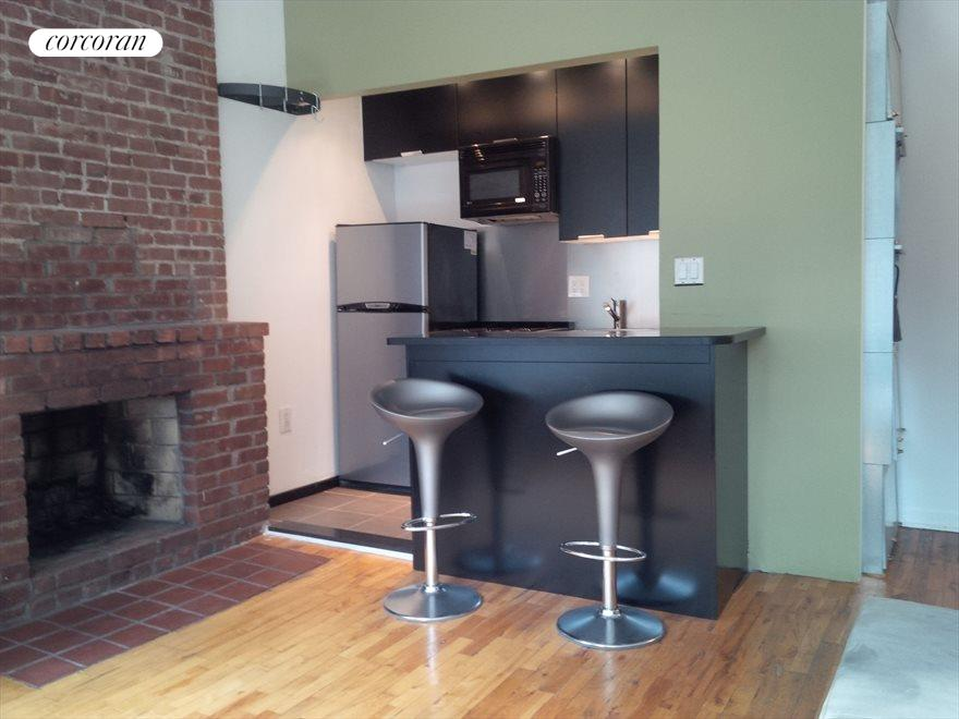 Upgraded Kitchen and Fireplace