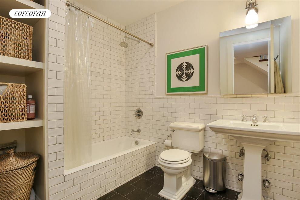 Classic New York Baths with Marble and Subway Tile