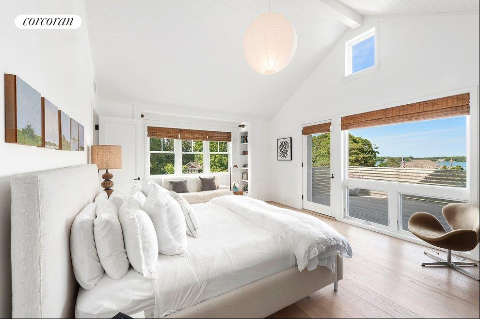 Master bedroom has balcony and water views