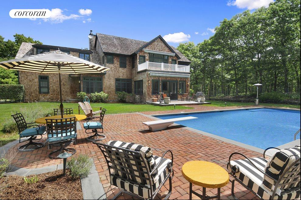 Open and spacious backyard with heated guinite pool