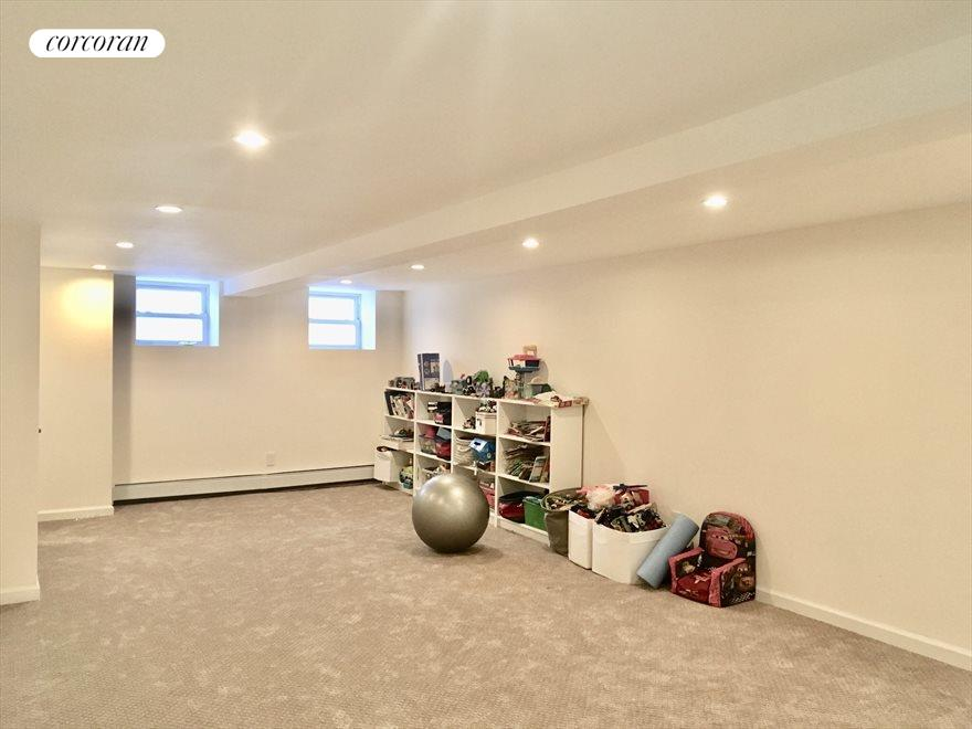 New York City Real Estate | View 1868 Hart Street, #1 | Playroom/Media Room