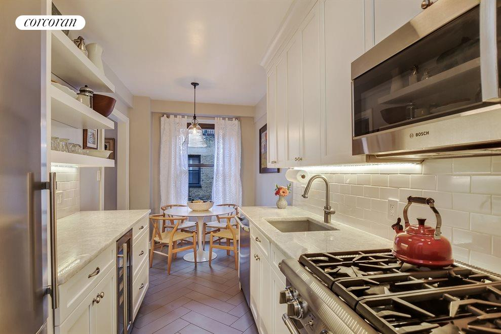 Windowed kitchen with top of the line appliances