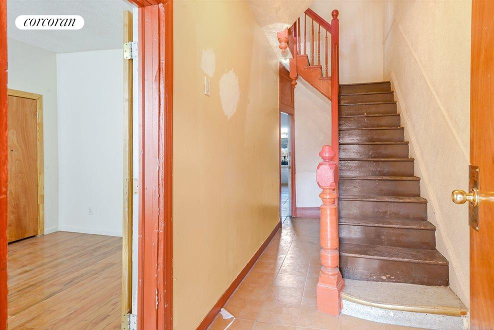 Entry Foyer with Solid Original Banister