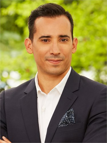 JC Vasquez, a top realtor in New York City for Corcoran, a real estate firm in Williamsburg Bedford.