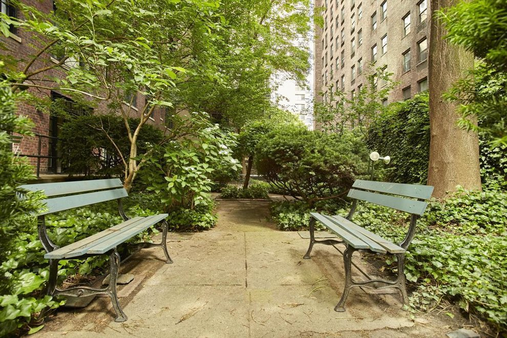 New York City Real Estate | View 230 East 50th Street, #5D | The quiet common courtyard has lush plantings.