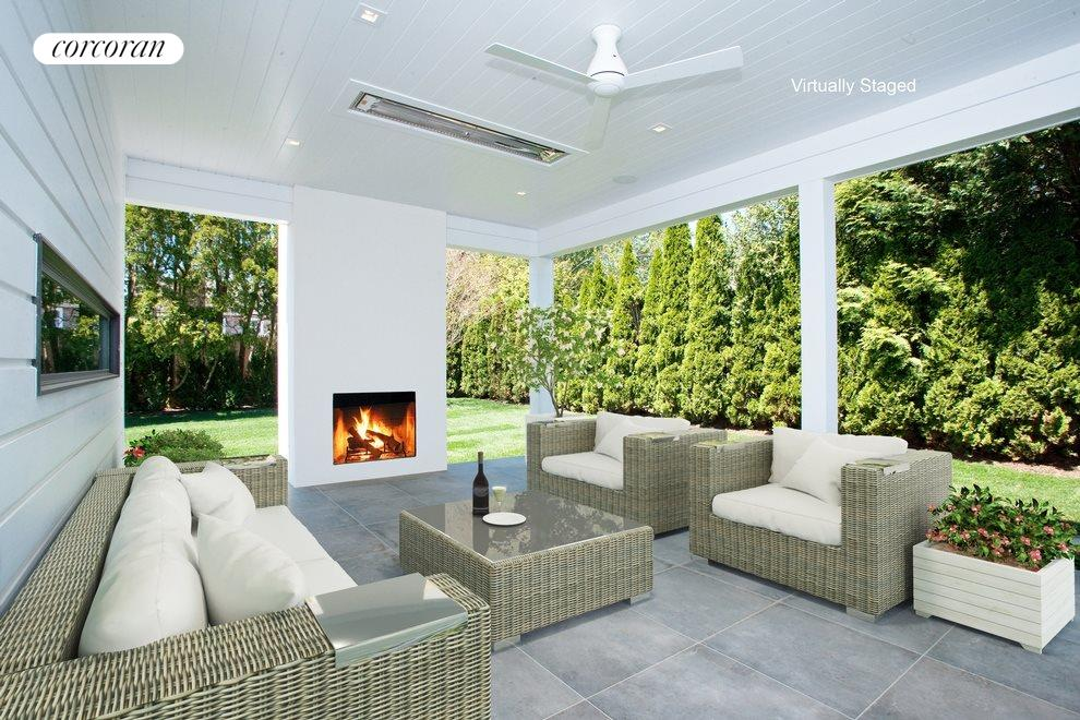 All season porch with heat lamps and fireplace