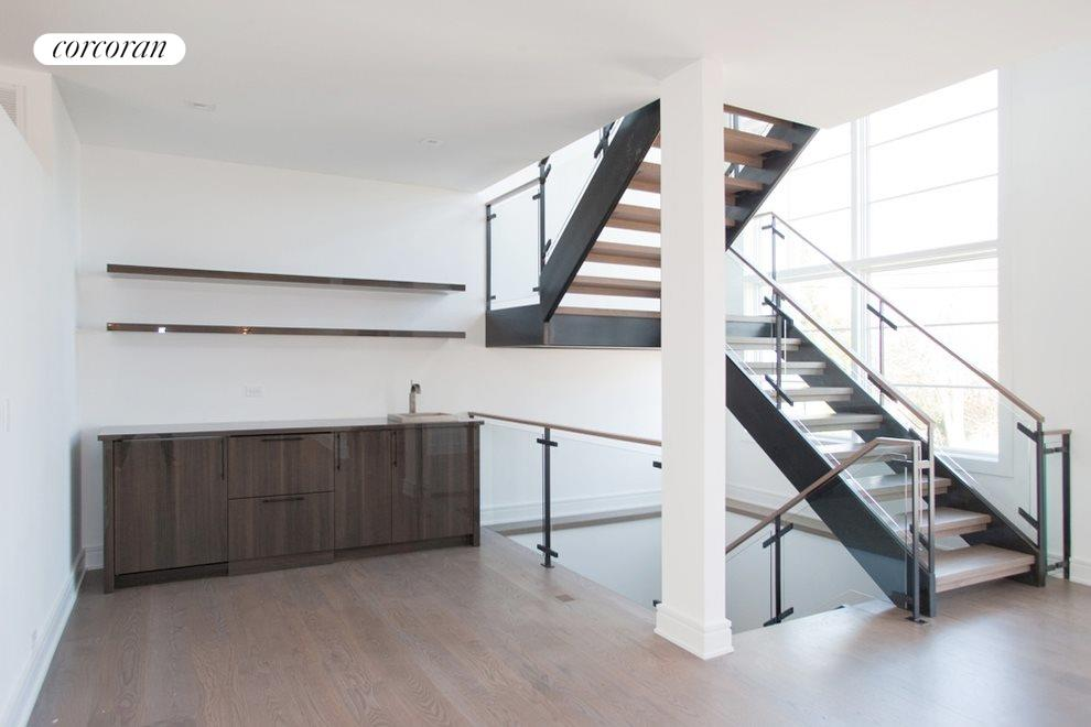 Steel and glass floating staircase/full wet bar