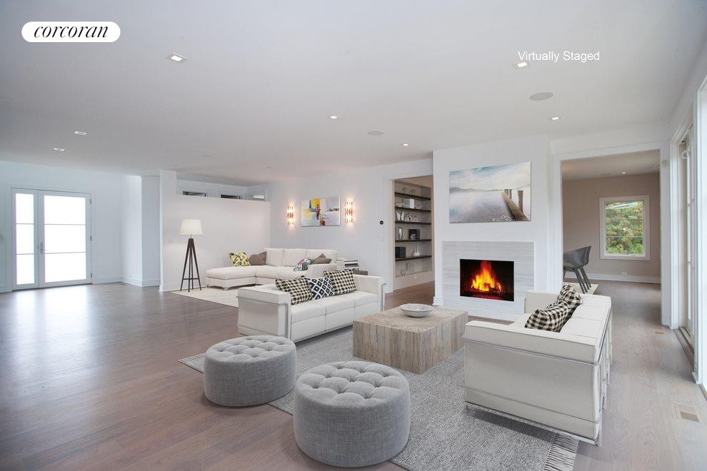 Virtual staging of living area with fireplace