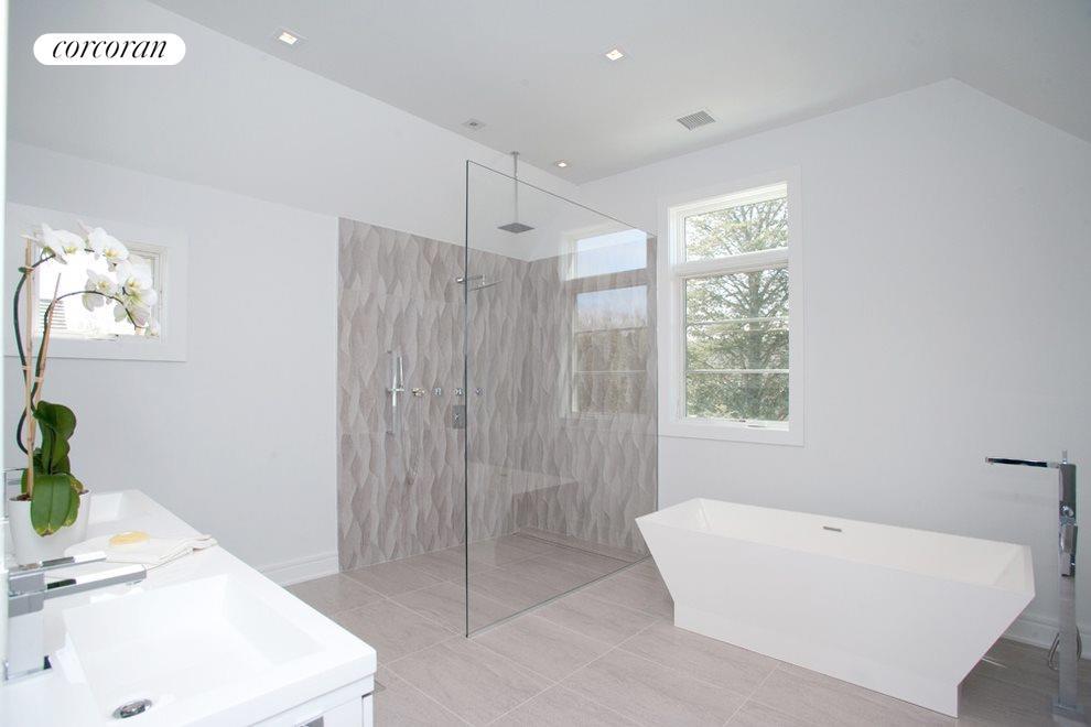 Free standing soaking tub and rain shower