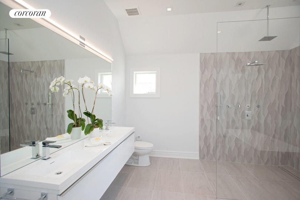 Double sinks in master bath with radiant hear