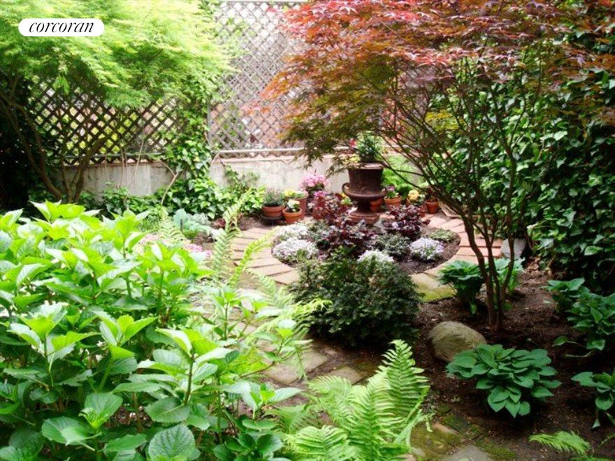 New York City Real Estate | View 313 Clinton Avenue, #1 | Private Garden in Bloom