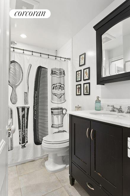 White tile shower/bath with large vanity