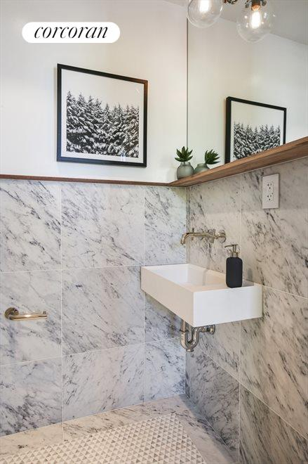 Stunning powder room with marble and custom sink