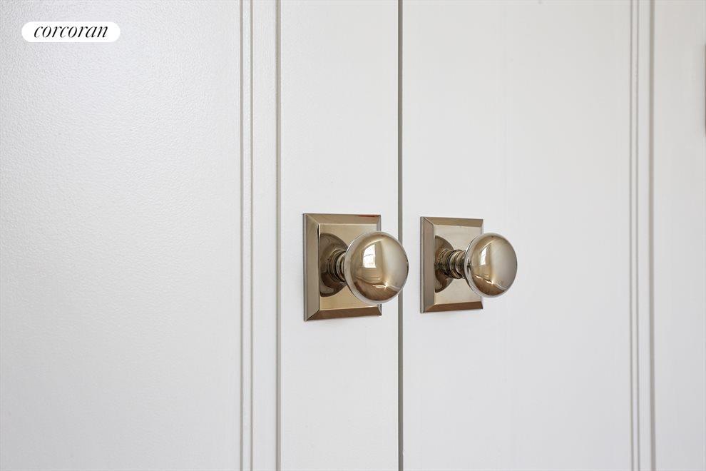 Stunning nickel hardware and hand-made doors