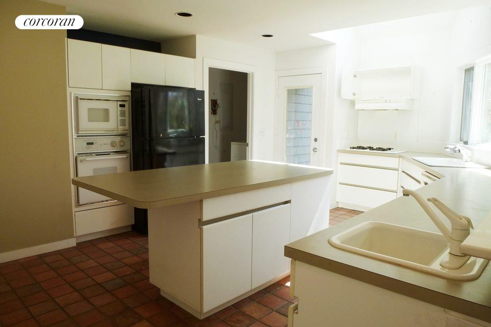 Kitchen that leads to laundry room and garage