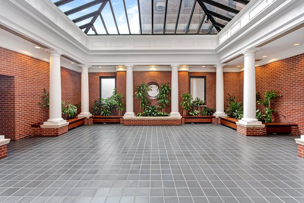 New York City Real Estate | View 188 East 70th Street, #8B | Soaring Residents' Atrium