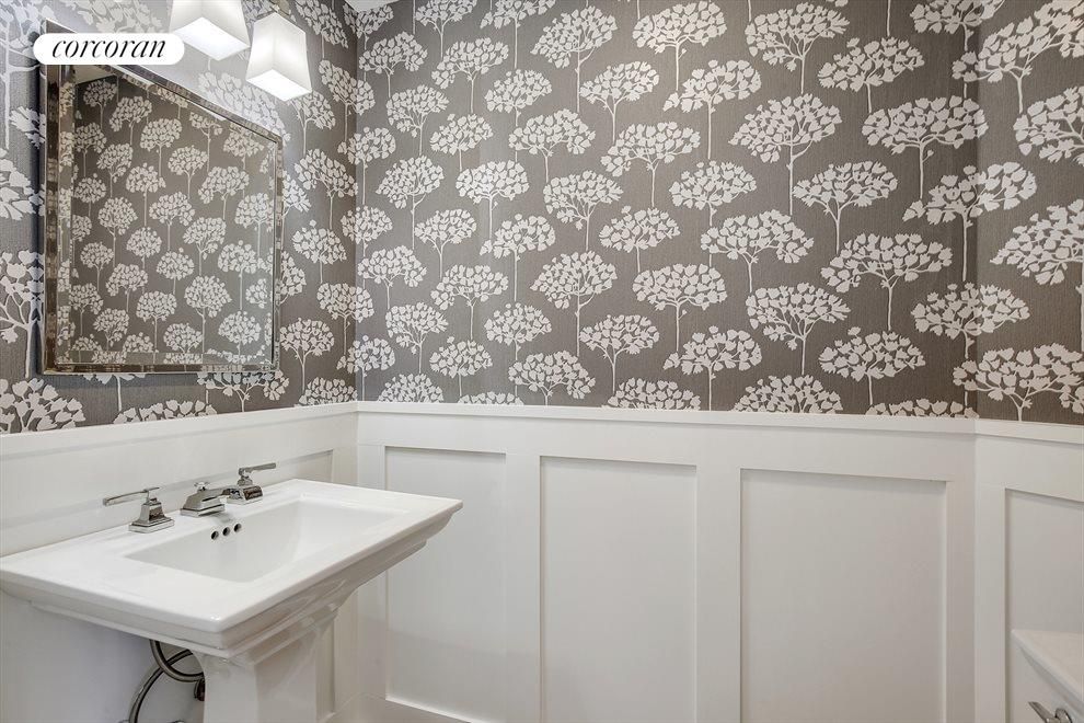 Wallpapered Half Bath with Wainscoting