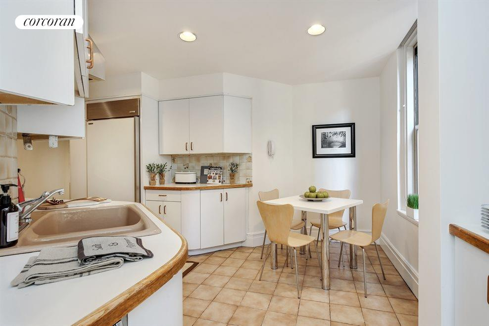 Abundant counter and cabinet space & washer/dryer