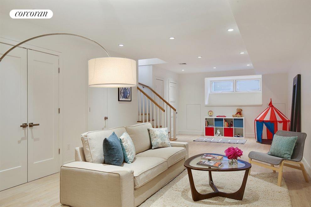 Generous Living/Recreation Room with many closets