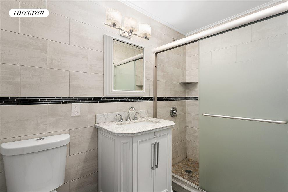 Floor to ceiling tiled bathroom