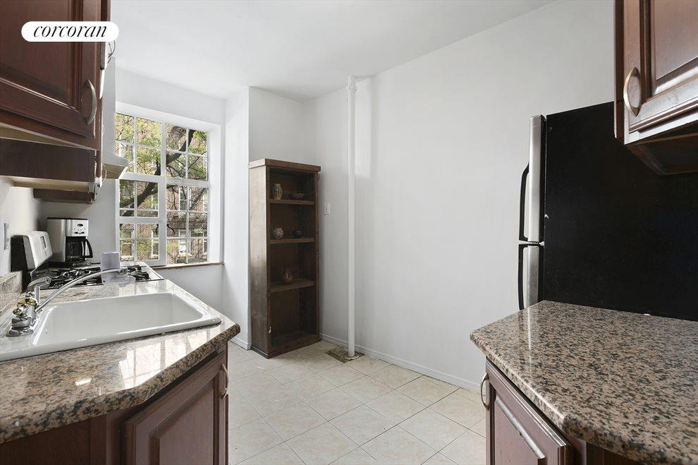 Windowed eat-in kitchen with ample storage