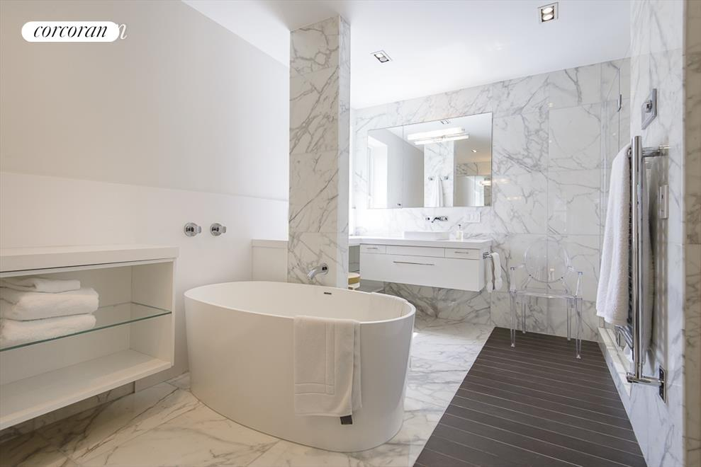 large master bath with double sinks, stall shower