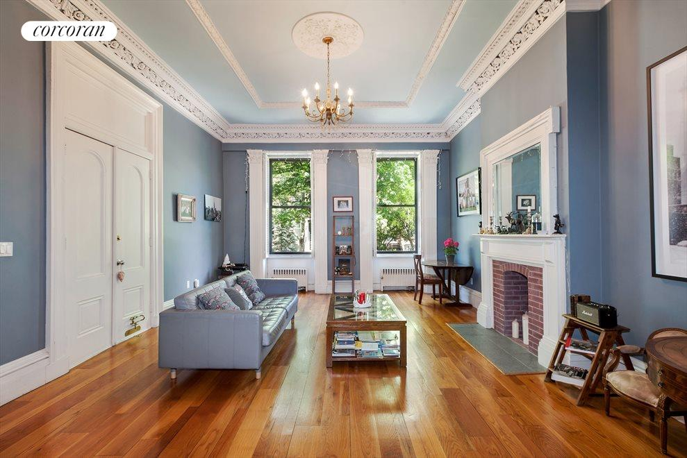 high ceilings and decorative molding throughout