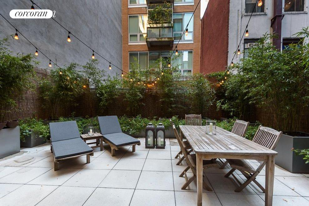 Expansive planted and irrigated terrace with grill