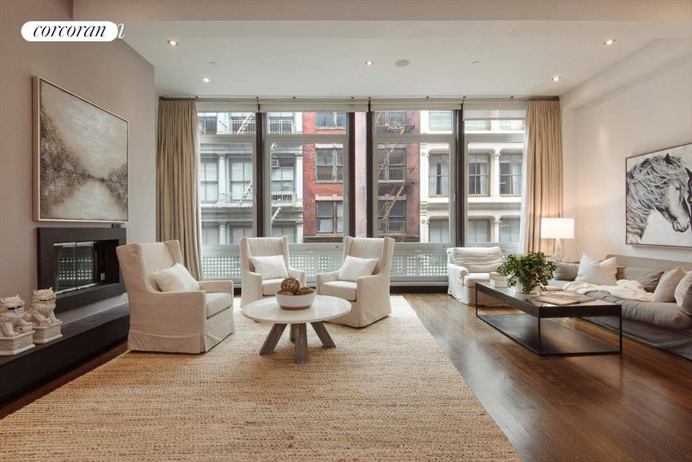 Living room overlooking Mercer Street w/ 11' ceil