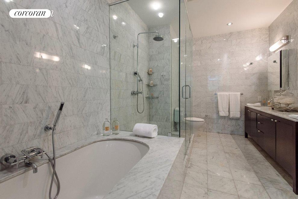 Marble  tiled Master bathroom
