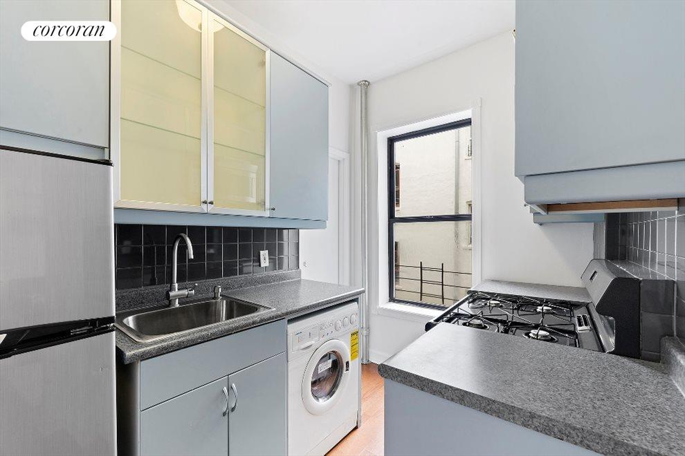 New York City Real Estate | View 311 East 3rd Street, #25 | Kitchen with Washer/Dryer