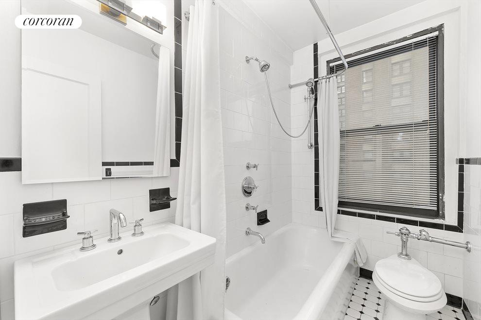 New York City Real Estate | View 162 West 56th Street, #1206 | Windowed Bathroom with large tub