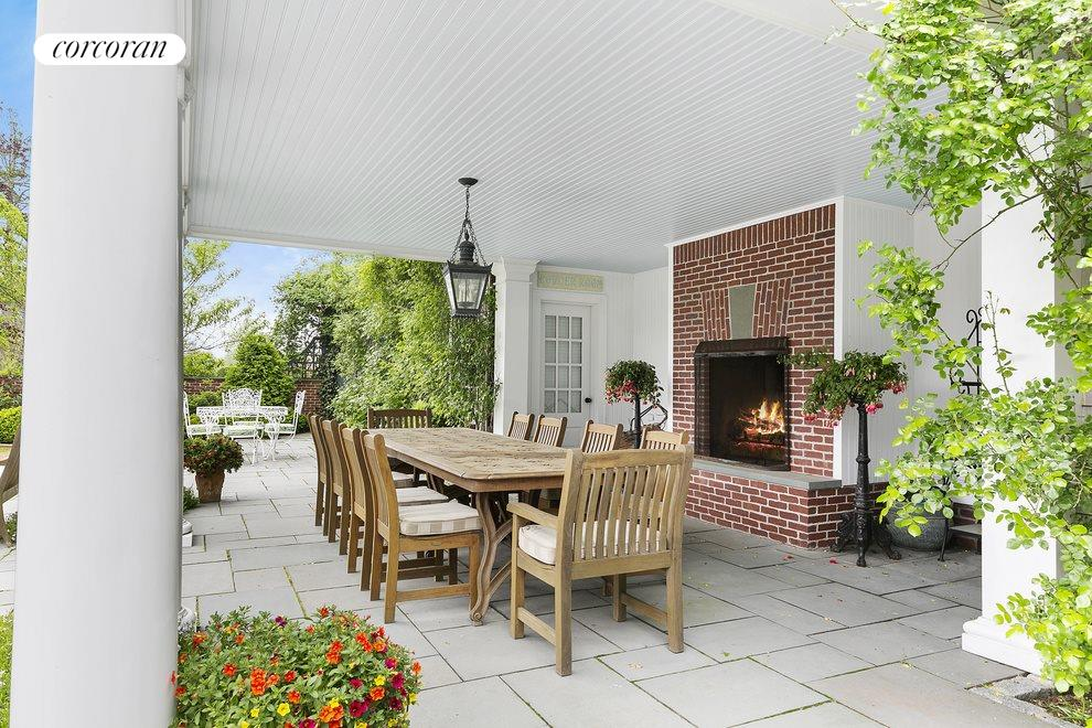 Outdoor Dining Terrace With Fireplace