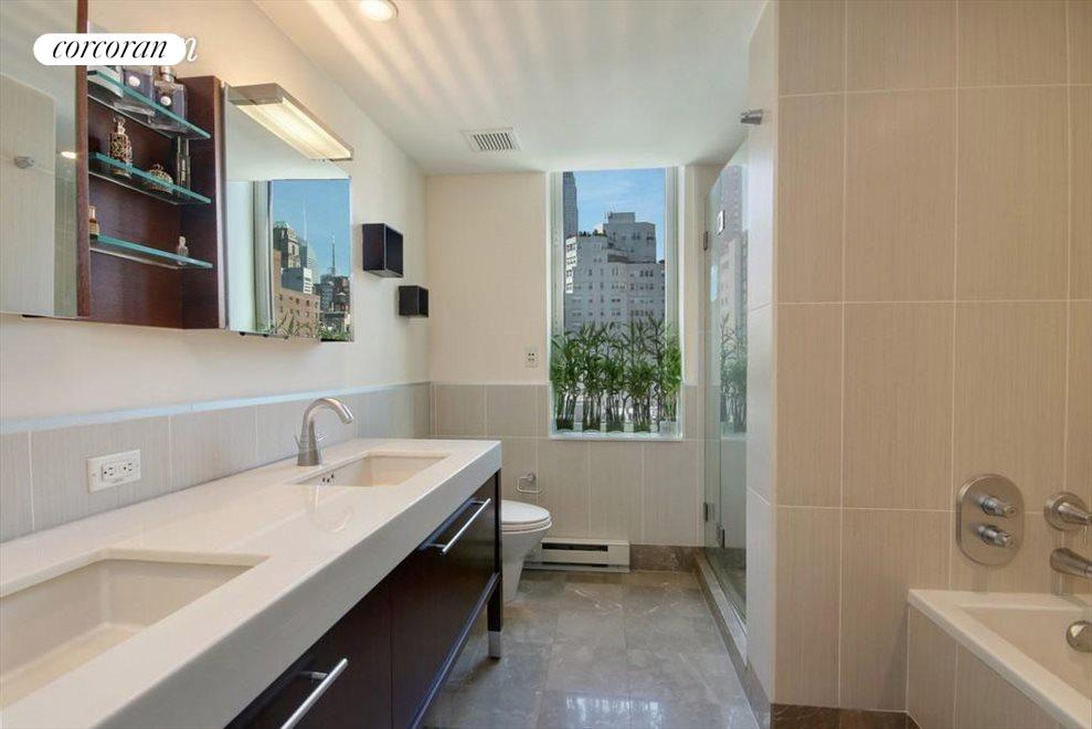 Master Bath w/ 2 sinks, soaking tub, and shower