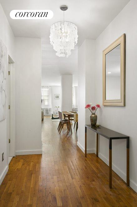 Expansive foyer graced with a large coat closet