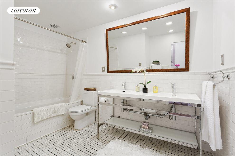 Spacious renovated bathroom offers double sinks