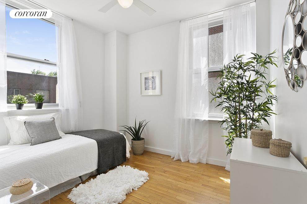 2nd bedroom with ample light from 2 large windows
