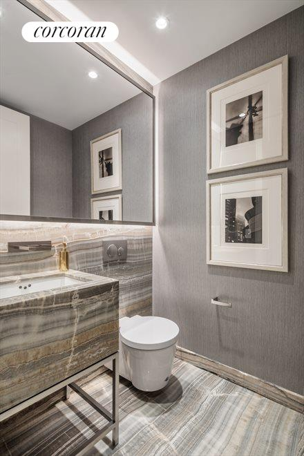 New York City Real Estate | View 70 VESTRY ST, #3F | Powder Room with custom designed onyx vanity