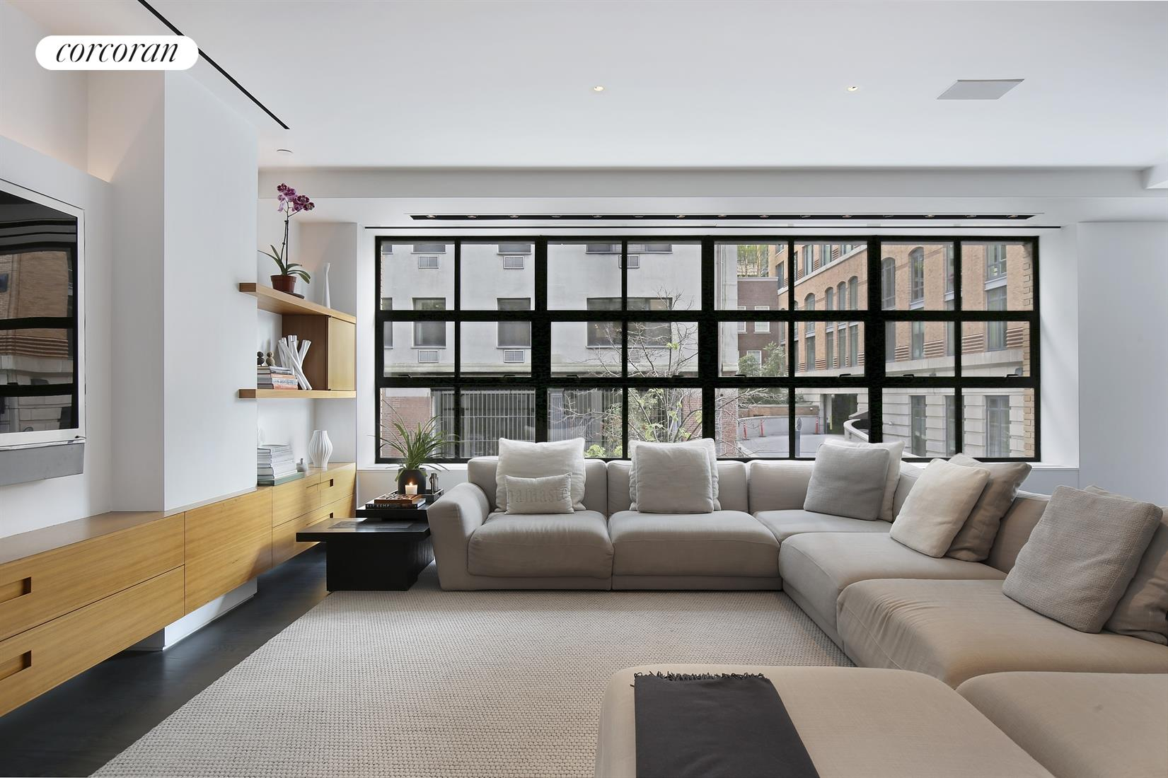 The allure of the West Village beckons at 397 West 12th Street!  An astute attention to detail was taken by well known designer Deborah Berke in building out this incredible custom home with tremendous flow and sensibility.  A full floor 4 bedroom 3.5 bath condominium in Manhattan's West Village, the home sprawls out over 3600sf with rare proportions boasting a true great room boasting an incredible 62 linear feet of lofty entertaining space!  Entertaining opportunities abound in this massive space comprised of an open plan living room, media room and dining room and a kitchen thoughtfully designed and outfitted for a true chef!  The space is dressed with beautiful south facing casement windows allowing for lots of direct sun to pour in with a corner window facing west providing peaks of the Hudson River, and stunning sunsets!  The custom kitchen features a cook center with sleek stainless steel back splash, lots of counter space, specialty appliance storage, spice bins, storage pantries,double Miele ovens, ventilation over a 6 burner Wolf cook top and grill, LED under cabinet lighting and an 11.5ft center island with double Bosch dishwashers and an abundance of storage including pull out pantries, pot, china and flatware drawers and more.  The home is run by a mobile Savant system which can open up or shut down the household with the touch of one button, and controls air conditioning, lighting, surround sound and blinds.  Off of the media area enjoy a double home office with sliding pocket door which hides the space when entertaining.  The bedroom wing features 3 bedrooms and a den or 4th bedroom with 3 full baths.  The master bedroom is spacious, very bright and modern with two custom walk-in closets and an en suite master bathroom with double vanity and radiant heated floors.  The second bedroom faces north with an unobstructed exposure over the rear of the building keeping things ultra quiet and yet very bright and open, and features an ensuite windowed bathroom