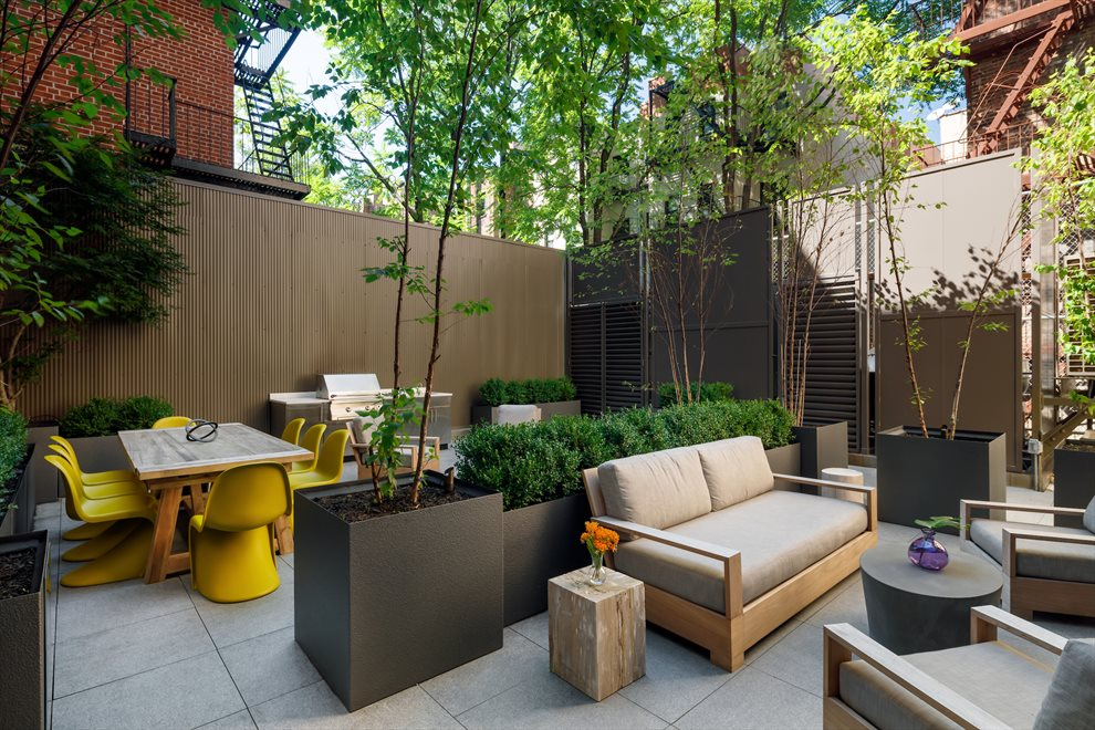 Common Outdoor Terrace Replete w/ a Grill