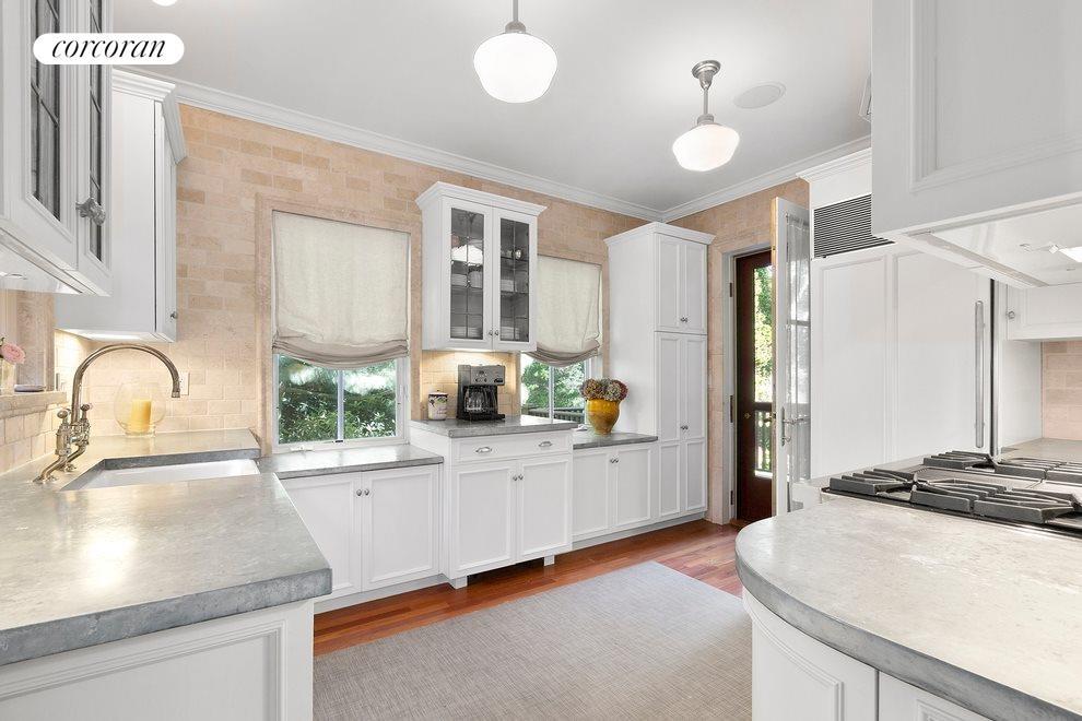 Kitchen with zinc countertops and door to deck
