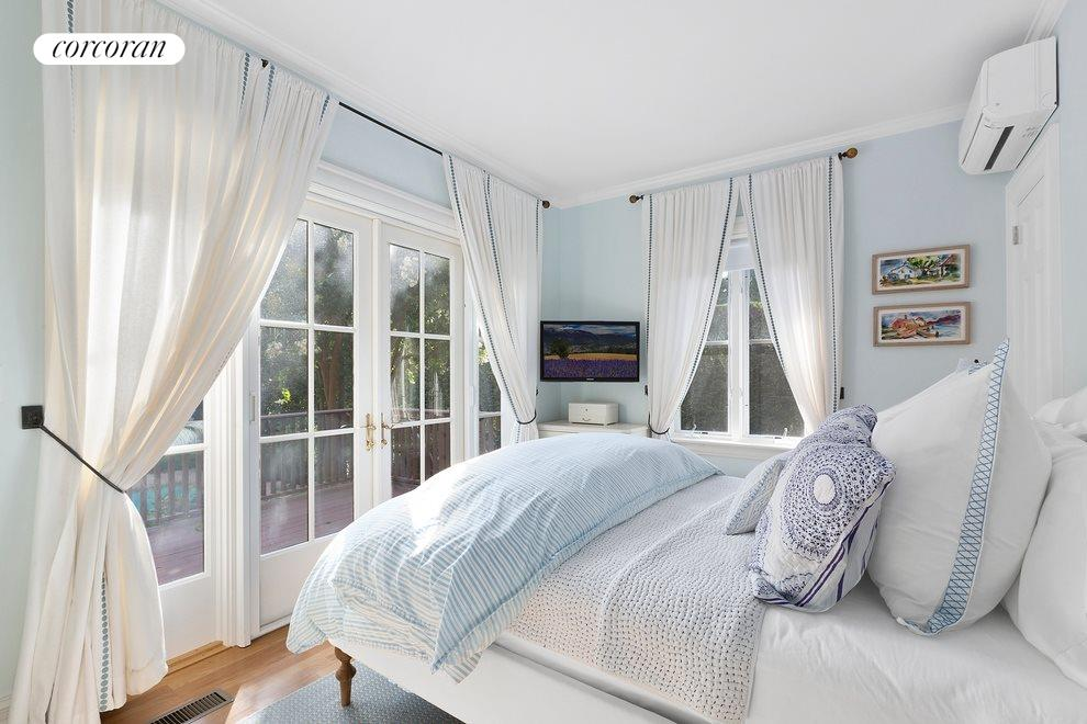 Guest bedroom with french doors to deck