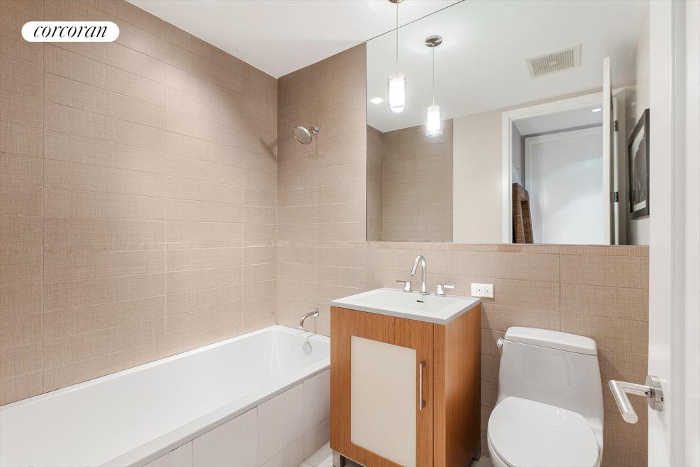 deep soaking tub in second bathroom
