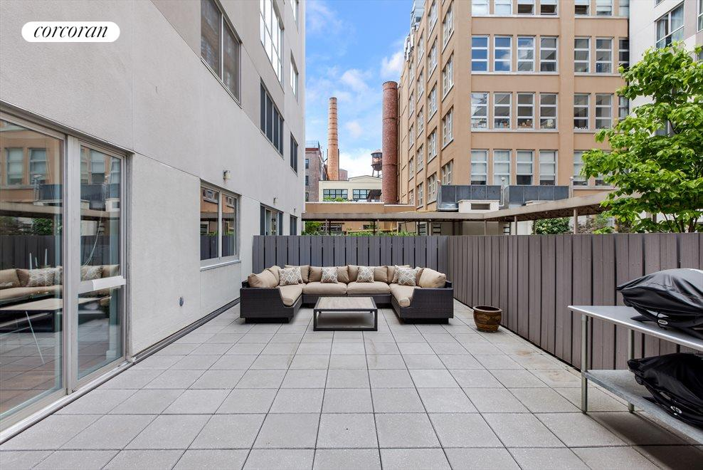 Fully furnished outdoor space with two grills