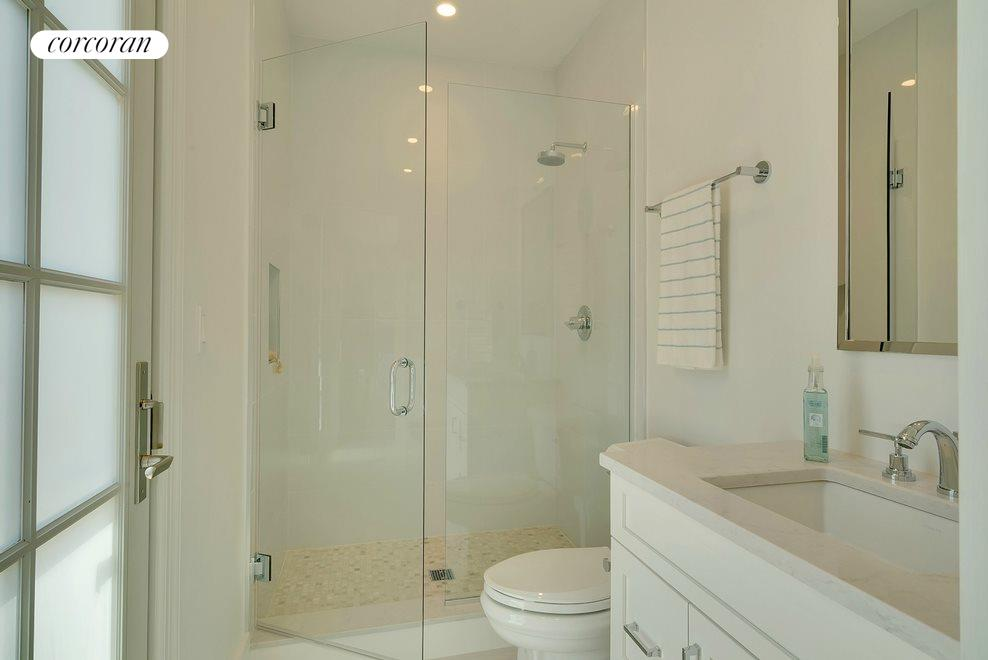 Junior Master bath that leads out to the pool area